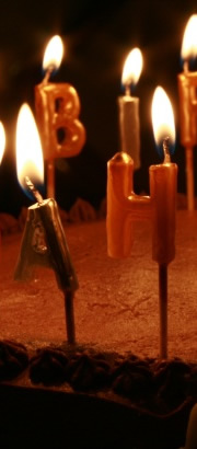 Birthday Candles Burning on a Cake