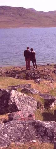 Couple standing looking at a Fjord