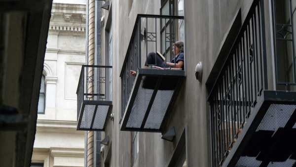 student studying on balcony